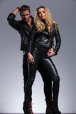 Young fashion couple in leather clother posing Royalty Free Stock Photography