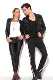 Young fashion couple in leather clothes looking at each other Royalty Free Stock Image