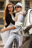 Young fashion couple in love at the retro car Stock Photo