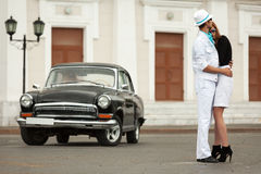Young fashion couple in love at the retro car. Young fashion men and women in love at the retro car Stock Photos