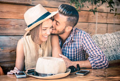 Young fashion couple of lovers at beginning of love story. Handsome men whispers sexy kisses in pretty women ear - Relationship love concept with boyfriend Royalty Free Stock Images