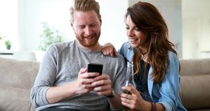 Young fashion couple of lovers playing with mobile royalty free stock images