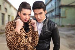 Young fashion couple posing near old factories. Royalty Free Stock Photography