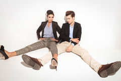 Young fashion couple relaxing on studio background Stock Images