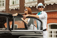 Young fashion couple at the retro car Royalty Free Stock Photography