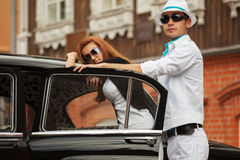 Young fashion couple at the retro car Stock Photos
