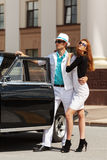 Young fashion couple at the retro car Stock Photography