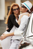Young fashion couple in love at the retro car. Young fashion man and woman in love at the retro car Royalty Free Stock Photo