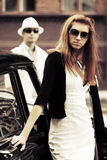 Young fashion couple by retro car Royalty Free Stock Photos