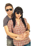 Young fashion couple with sunglasses Royalty Free Stock Photo