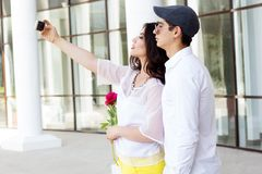 Young fashion couple taking selfe outdoors Royalty Free Stock Images