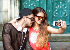 Young fashion couple taking selfie in the Stock Images