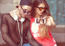 Young fashion couple taking selfie Stock Photo