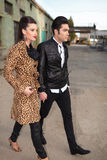 Young fashion couple walking forward, holding hands. Royalty Free Stock Image