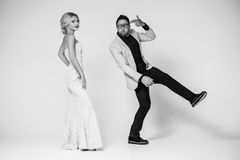 Young fashion couple on a white background in studio Royalty Free Stock Image