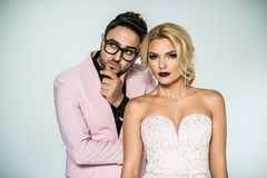 Young fashion couple on a white background in studio Stock Images