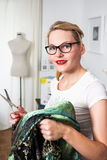 Young fashion designer with scissors Royalty Free Stock Photo