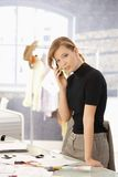 Young fashion designer talking on mobile Stock Photo