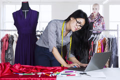 Young fashion designer using laptop Stock Photos