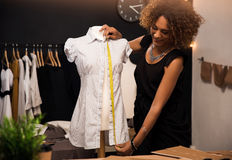 Fashion designer. Young fashion designer working on her atelier Stock Photos