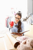 Young fashion designer working in her studio Stock Images