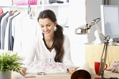 Young fashion designer working in her studio Royalty Free Stock Photography