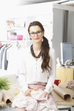 Young fashion designer working in her studio Stock Photography