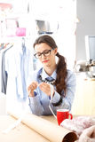 Young fashion designer working in studio. Royalty Free Stock Image