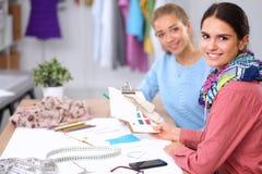 Young fashion designer working at studio. Modern young fashion designer working at studio Stock Image