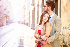 Young fashion elegant stylish couple posing on streets of europe Stock Images