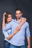 Young Fashion Expressing Couple In Jeans Stock Image