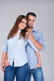 Young fashion expressing couple in jeans Stock Photos