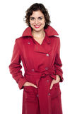 Young fashion female wearing trendy topcoat Royalty Free Stock Photography