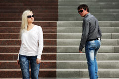 Young fashion couple flirting on the steps Stock Photos