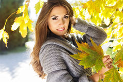 Young fashion girl in autumn park Royalty Free Stock Photography