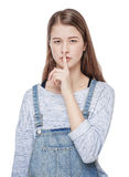 Young fashion girl with finger on lips isolated Royalty Free Stock Photography