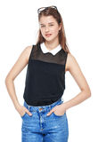 Young fashion girl in jeans and glasses posing isolated. On white background stock photography