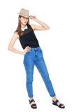 Young fashion girl in jeans and hat posing isolated Stock Photos