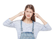 Young fashion girl in jeans overalls making crazy gesture isolat Stock Images