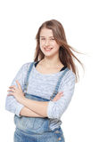 Young fashion girl in jeans overalls posing isolated Stock Photos