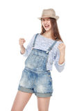 Young fashion girl in jeans overalls with yes gesture isolated. On white background royalty free stock images