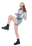 Young fashion girl in jeans overalls with yes gesture isolated. On white background royalty free stock photos