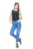 Young fashion girl in jeans posing isolated Stock Photography