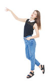 Young fashion girl in jeans posing isolated Stock Image