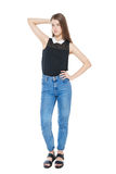 Young fashion girl in jeans posing isolated. On white background stock photos