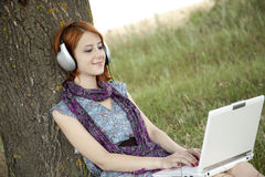 Young fashion girl with notebook and headphones Royalty Free Stock Photo