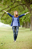 Young fashion girl at spring outdoor. Royalty Free Stock Photo