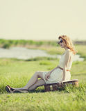 Young fashion girl with suitcase   Royalty Free Stock Images