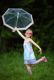 Young fashion girl with umbrella Stock Images