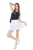 Young fashion girl in white skirt posing isolated Stock Photo